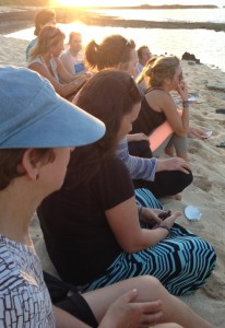 attendees sitting on the beach